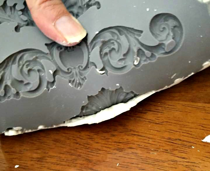 Bend the mould to release the clay