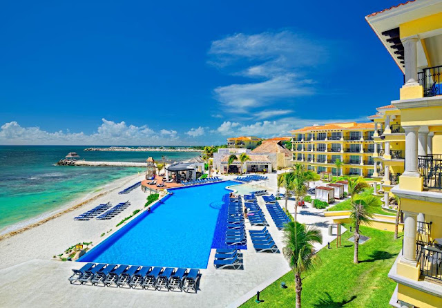 Take in the tranquility and variety of the Riviera Maya as it was meant to be seen. Step up to Hotel Marina El Cid Spa & Beach all-inclusive Caribbean family resort dedicated to a natural paradise of warm azure waters, soothing breezes, and rare tropical plants bursting with color.