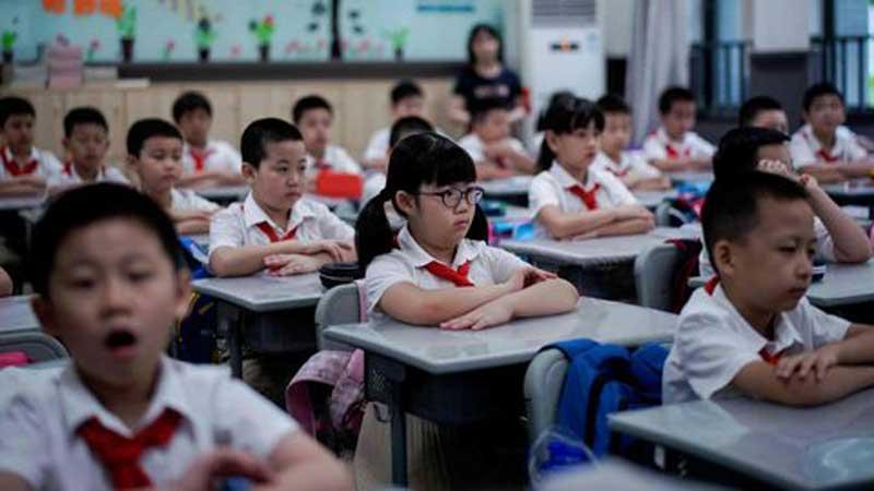 China Larang Ujian Tertulis dan PR untuk Murid Kelas Satu dan Dua SD