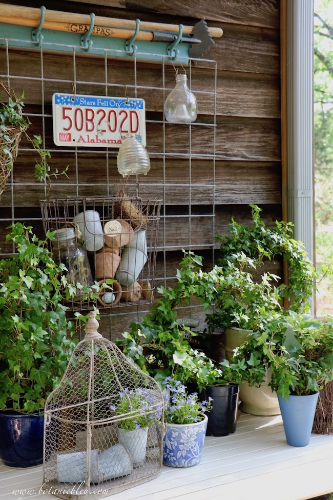 French Country Spring potting table displays ivy wreaths and wire mesh birdcage