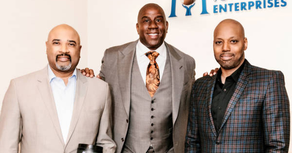 Magic Johnson with the owners of Naturade