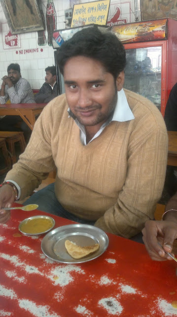 Janak Kumar Yadav from howrah loves the special sunday treat with friends, eating Hing Kochuri inside Dakshineswar Kali Temple
