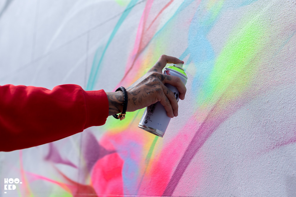 Brazilian street artists L7M at work on his mural in Cheltenham