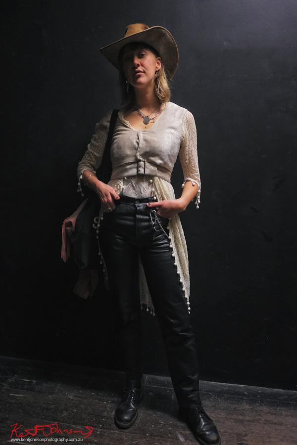 Unique layering of lace shirt under a belted vest, jeans and a leather stockmans hat. Photography by Kent Johnson for Street Fashion Sydney.