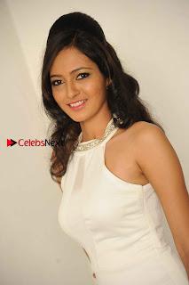 Kannada Actress Nidhi Latest Pos in White Short Dress at Vega Movie Launch Press Meet  0003.jpg