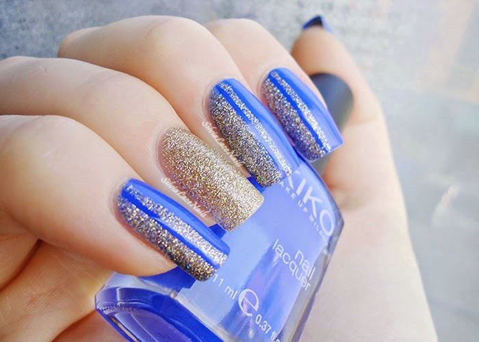 Blue and gold glitter nail art