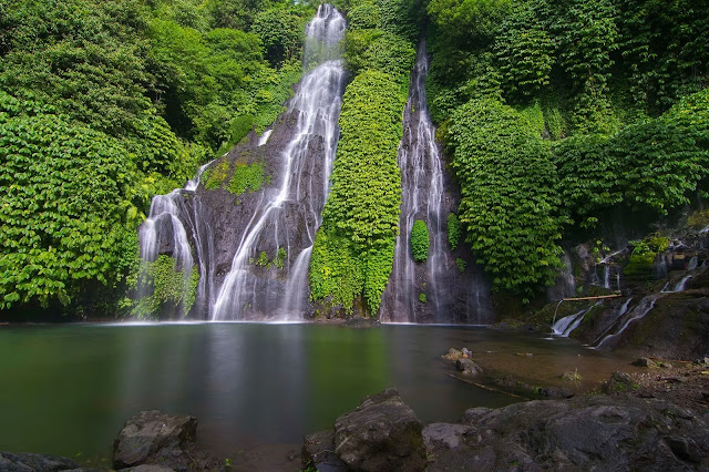 Discovering the hidden waterfall in the forest in Bali indonesia