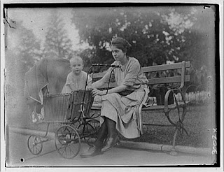 Fritzie Horydczak sitting on bench with Norma in a baby carriage
