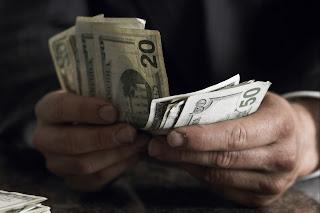 Menukar Uang Tunai pada waktu Terpisah