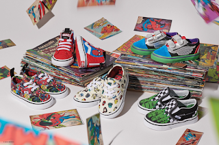 A birds eye group shot of several pairs of Vans including classic red and white Vans, red and black vans, red vans with small white detailing, silver and light blue Vans and white slip-ons with animated detailing of Avengers on a white background.