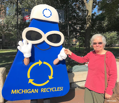 person in recycle suit