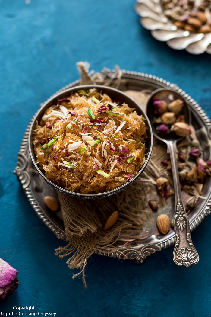 This sweet vermicelli is quick and easy Indian pudding that is served in a brass bowl and garnished with red dried rose petals, green pistachio.