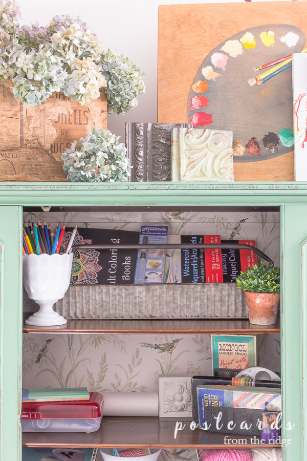 art and craft supplies organized with metal toolbox, milk glass