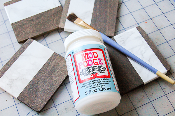 Applying dishwasher sage mod podge to wood coasters