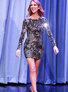 Celine Dion at the Tonight Show with Jimmy Fallon in a silver sequin long sleeve mini dress