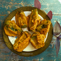 Capsicum fritters are very tasty and very easy to prepare. Pieces of capsicum are dipped into a spicy chickpea batter and then fried till golden brown or till crisp.