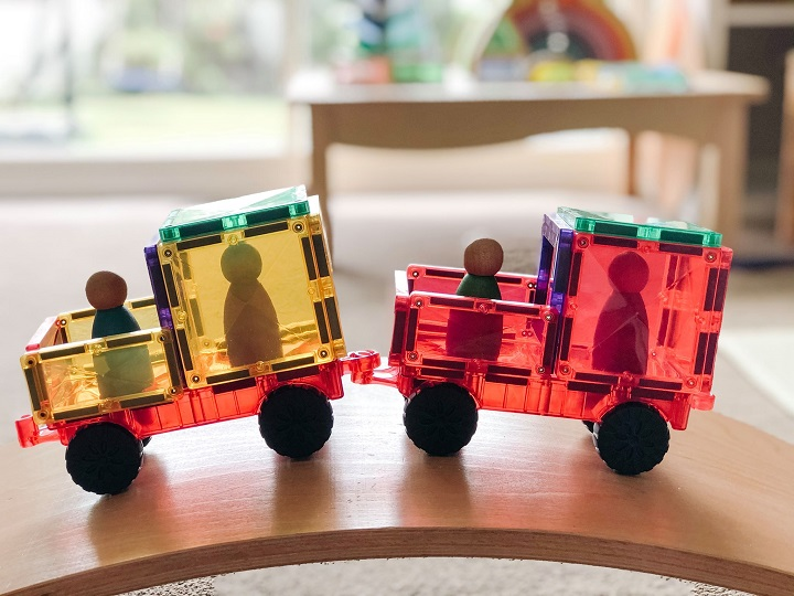 Connetix train with peg people on a wobbel board