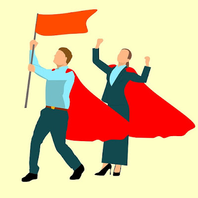two people with capes and flags acting very victory-ish