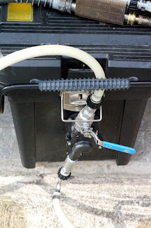 March pump mounted in a plastic tool chest.