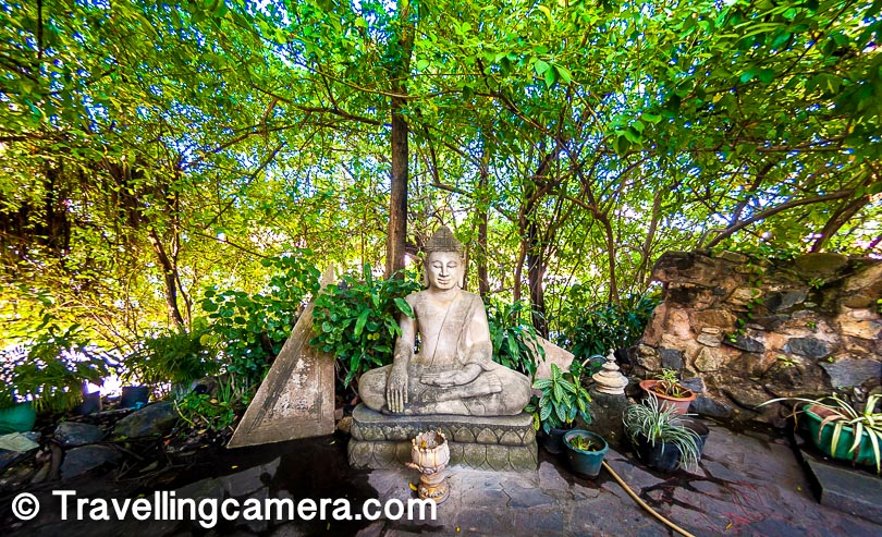 """Here are the """"Gardens of Kailasa Mountain"""". Sounds familiar? This is a cool, shady area with lush green palms and other tropical trees surrounding the central temple and the many statues of Buddha that surround it. It is a great place to catch a rest at for it is bound to be several degrees cooler than the surroundings."""