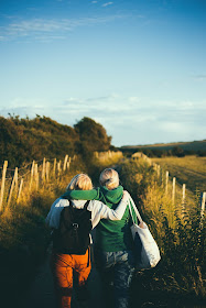 female friends walking a country path