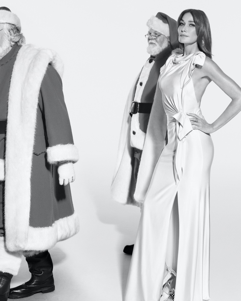 Carla Bruni poses with Santas in Burberry Holiday 2019 campaign