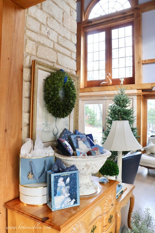 French country blue Christmas presents wrapped in gift bags and boxes previously used is environmentally friendly