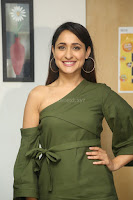 Pragya Jaiswal in a single Sleeves Off Shoulder Green Top Black Leggings promoting JJN Movie at Radio City 10.08.2017 092.JPG