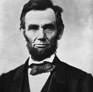 He is the 16th President of The United States . His father's was a farmer and his family was very poor , Living in a small one-room log cabin . While Lincoln was still very young , his family moved to Indiana and then again to llinois . He only went to school for one year but he loved books and learning and taught himself as much as he could