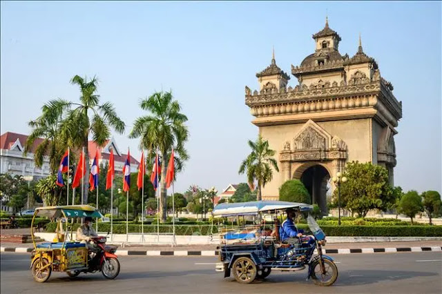 People move on the street in Vientiane, Laos. Photo: AFP