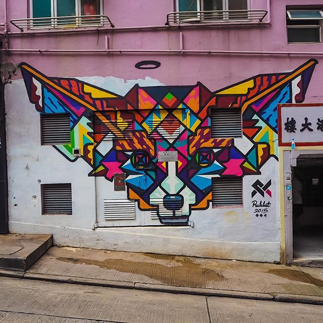 Neon geometric cat street art