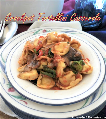 Crockpot Tortellini Casserole is a quick to assemble versatile meal. Frozen tortellini are layered with vegetables and sauce. Choose meatless or add meat, this casserole can also be baked in the oven. | Recipe developed by www.BakingInATornado.com | #recipe #dinner