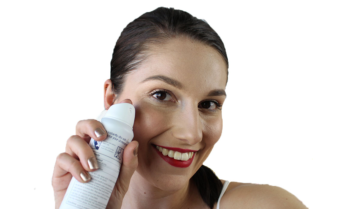 This is a photo of me testing out the new Dove Dry Spray Antiperspirant.