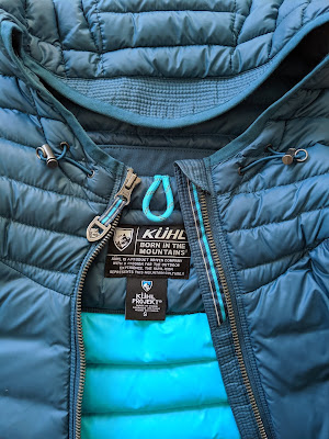 Close up of toggles on KÜHL Spyfire Down Hoody hood (front)