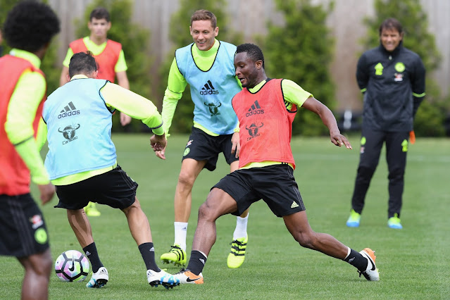 John Obi Mikel in chelsea training as Chelsea boss Antonio Conte watches on