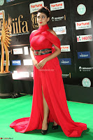 Apoorva in a Stunning Tight Leg Split Sleeveless Red Gown at IIFA Utsavam Awards 64.JPG