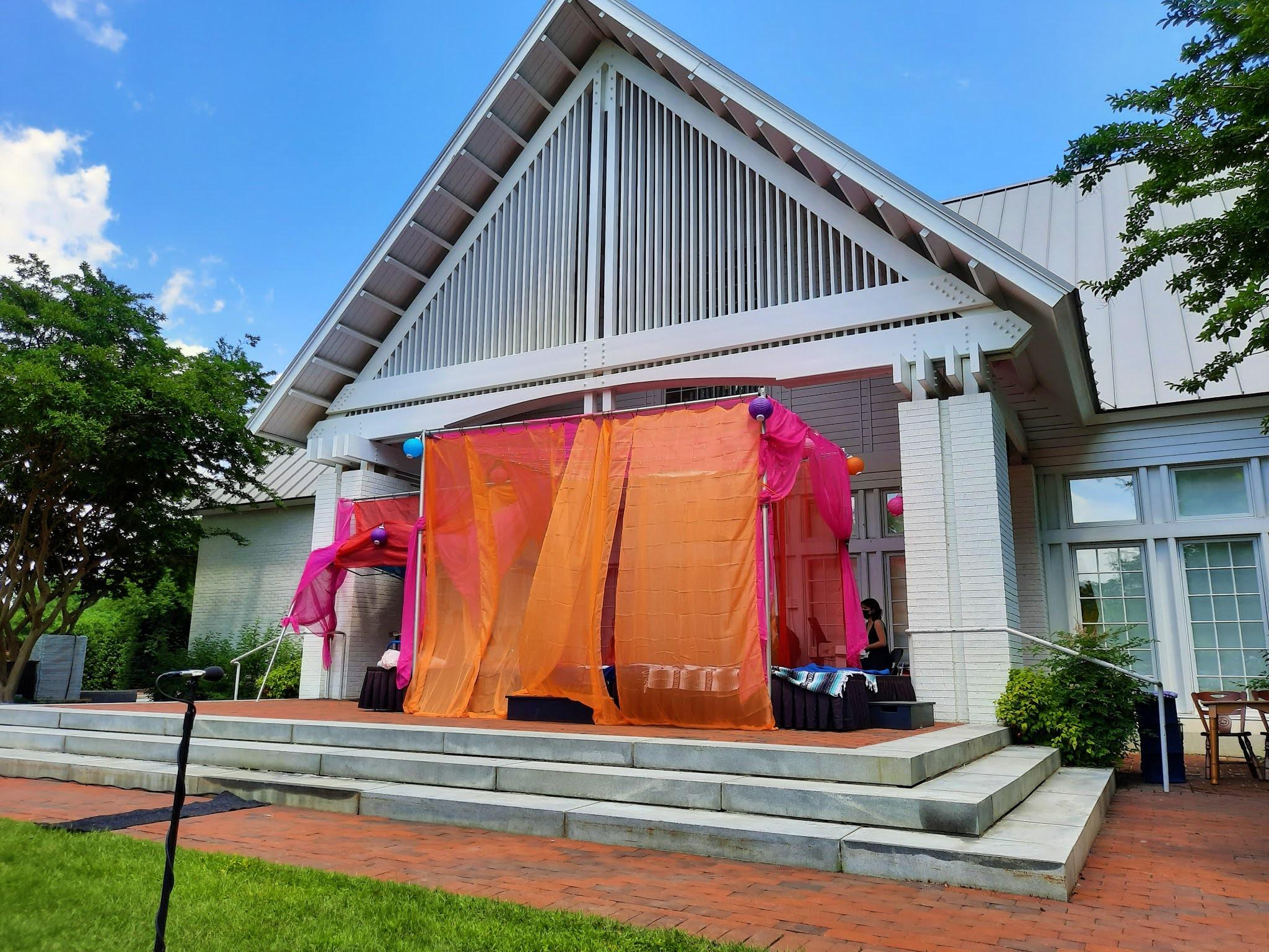 IN REVIEW: the porch of Williamsburg Community Building, setting for Opera in Williamsburg's June 2021 production of Ruggero Leoncavallo's PAGLIACCI [Photograph © by Joseph Newsome]