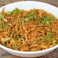 Chaumin is a type of noodle.which is made from wheat flour and fine flour. It is Looks like a thin thread but after cooking it looks very tasty and delicious.It is eaten with tomato chutney and sauce.In this, cabbage, carrot, capsicum are added while cooking.People of Bhutan Nepal and China like Chaumin very much.