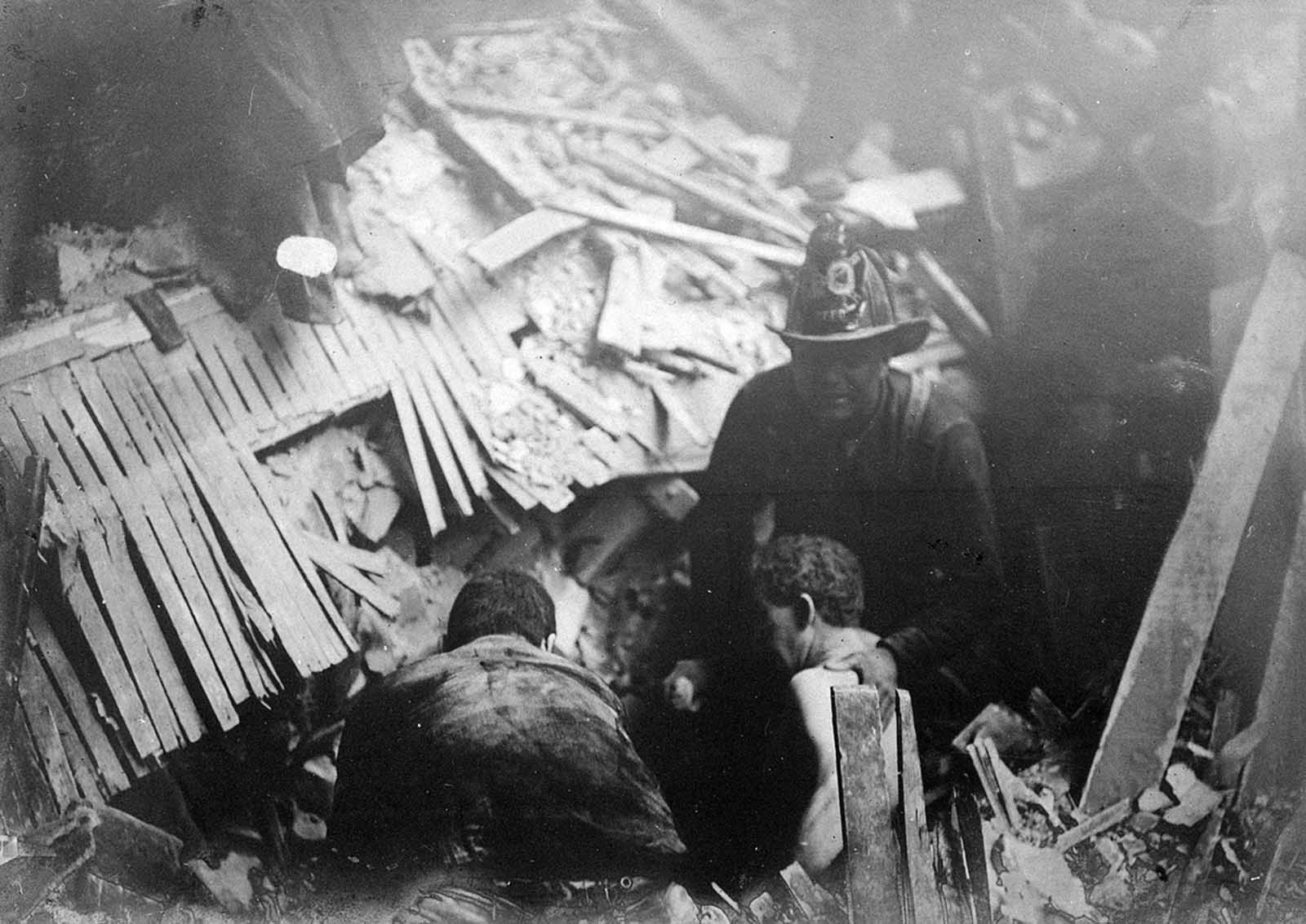 Rescue workers helping survivors in the wreckage.