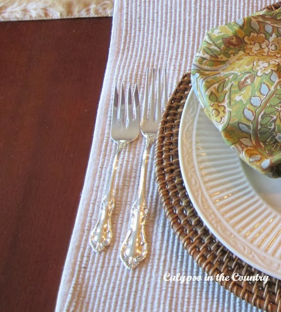 Silver forks on placemat