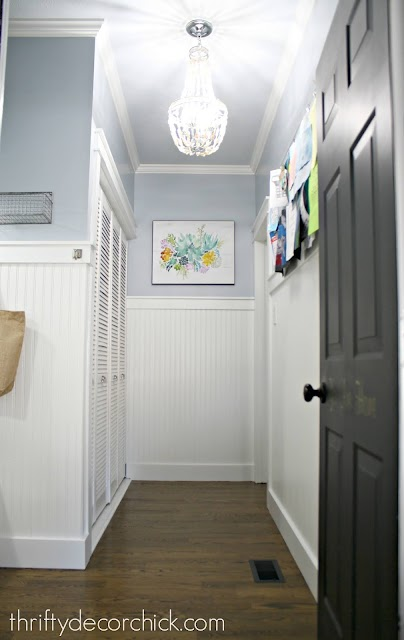 mud room with light blue walls white beadboard