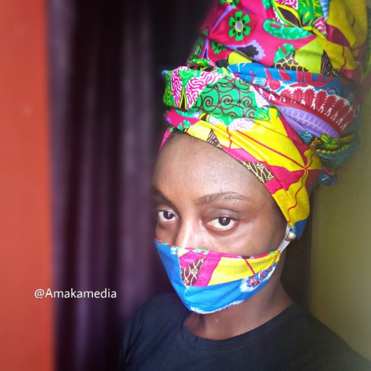 Amakamedia wearing Ankara face mask