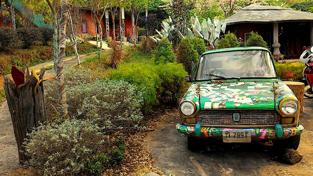 Sticker-covered car at Jakawan Baandin Chiang Mai
