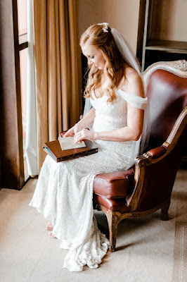 bride reading note before ceremony