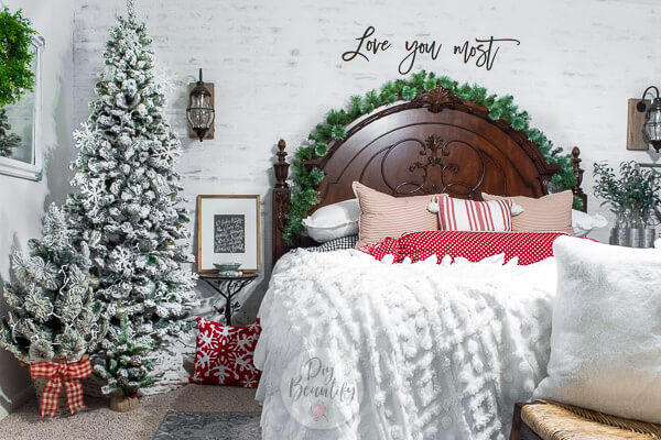 cozy white Christmas bedroom with pops of red