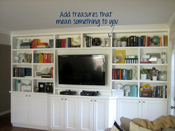 Tons of great tips and tricks on how to style a bookshelf - even a really big one like this built in!