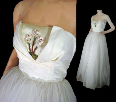 White chiffon party gown with flower embroidered inset shelf bust