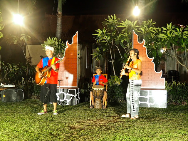Local children performing Balinese music in Kubuku hotel, Pemuteran, Bali, Indonesia