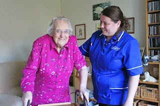 Caremark carer assisting customer