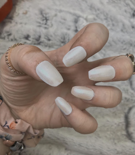 white nails on a fluffy background